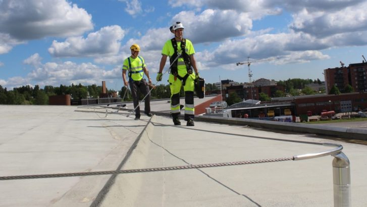 XS Platforms Fall Restraint Cable System demonstrated by two working at height specialists