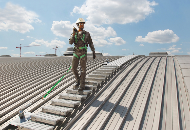 man on roof walkway