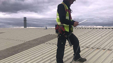 Man on roof checking working at height safety systems