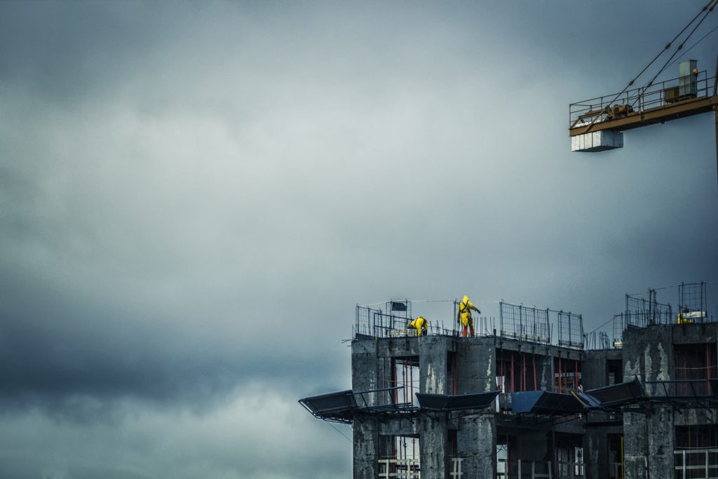 Stormy and windy construction site working at height